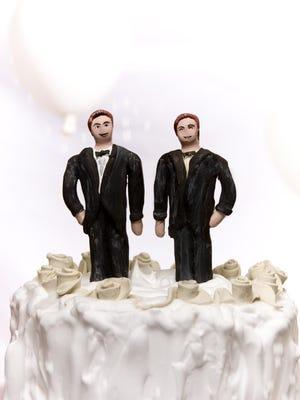 Gay wedding cake topper.