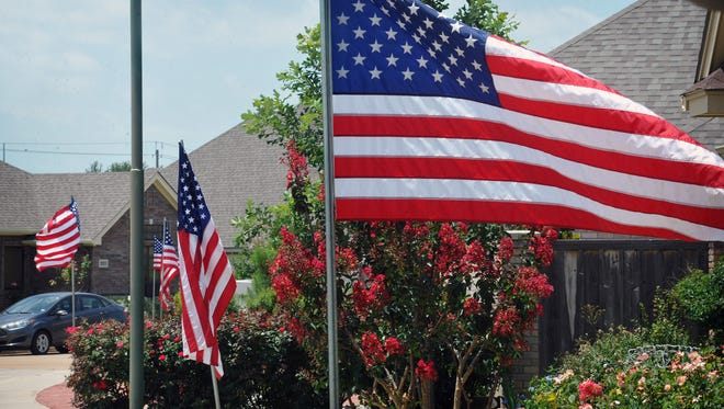 The Stars and Stripes added even more color to a neighborhood with blooming crepe myrtles and roses Wednesday. Flag Day has been celebrated since 1916, when President Woodrow Wilson made an official proclamation.
