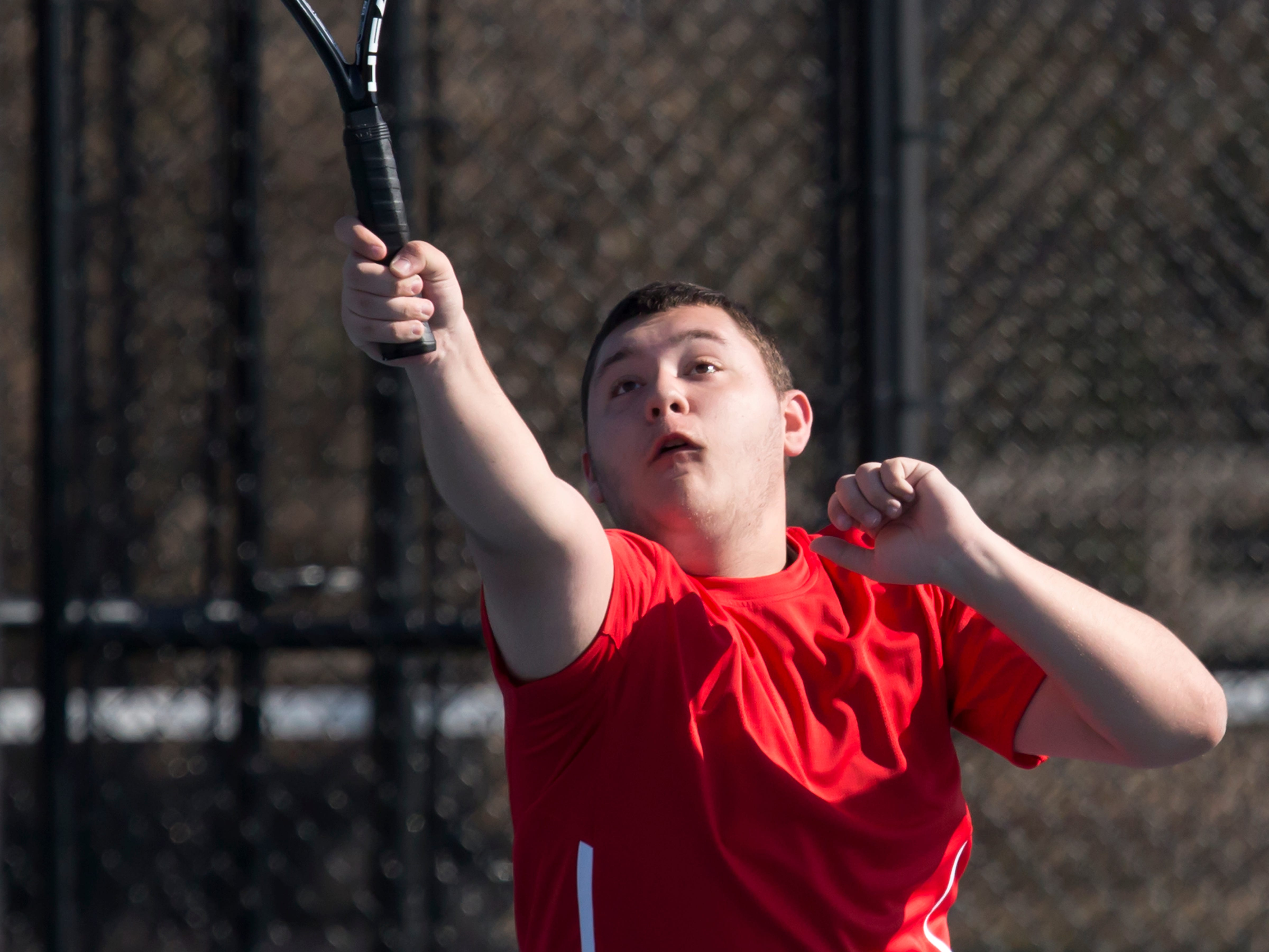 Sheboygan South's Ermin Kosaric hits a return playing in a singles match against Oshkosh North at the Bill Van Leishout courts April 11, 2015.