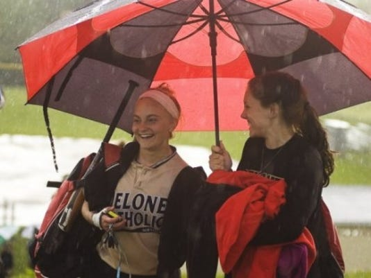Delone Catholic's Deanna Laughman, left, and Madison Shockey of Susquehannock walk off the field after a rain postponement last season. (GAMETIMEPA.COM -- FILE)