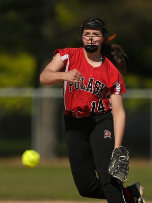 Pulaski's Liz Pautz fires a pitch during Thursday's game against Green Bay Southwest at John Muir Park in Green Bay. The Red Raiders won 3-0 to clinch the outright FRCC title.