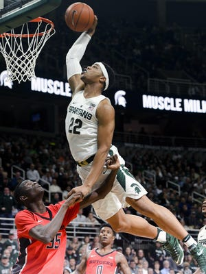 Dave Wasinger/Lansing State Journal Spartans forward Miles Bridges dunks over Rutgers guard Issa Thiam during the Big Ten basketball matchup between Rutgers and Michigan State at the Breslin Center on Wednesday in East Lansing. Bridges finished with six points and six rebounds. Spartans forward Miles Bridges (22) dunks over Rutgers guard Issa Thiam (35) during the Big Ten basketball matchup between Rutgers and Michigan State at the Breslin Center Wed, Jan. 4, 2017 in East Lansing. Bridges finished with six points and six rebounds.