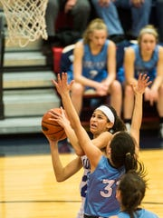Cedar Crest's Ariel Jones drives to the hoop against