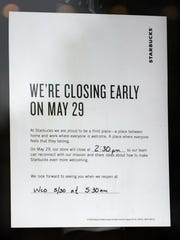 A sign on the door of the Starbucks on Kenneth Road