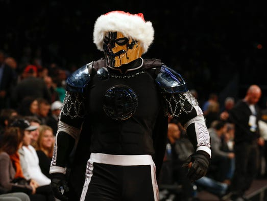 Nets mascot Brooklyn Knight got into the holiday spirit for a game against the Bulls. Flip through this gallery for more Christmas Day photos.