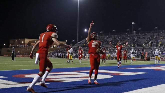 Coronado wide receiver Eli Martinez (27) celebrates after scoring a touchdown during the Mustangs' season opener against Frenship on Sept. 25 at PlainsCapital Park at Lowrey Field.