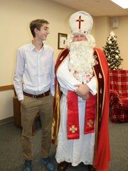 Aidan Shank, 16, of Sheboygan, poses with St. Nick