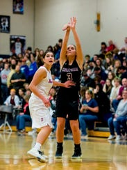 Cheatham County's Emmy Nelson shoots a 3-pointer.