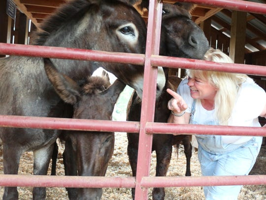 Alisa Lear with her rescue donkeys.
