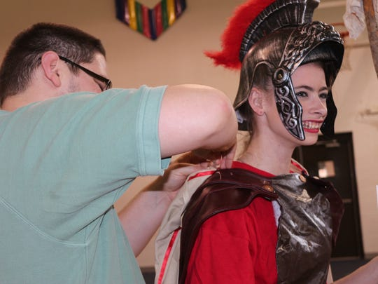 Juri Thompson helps Allison Lau with her costume for