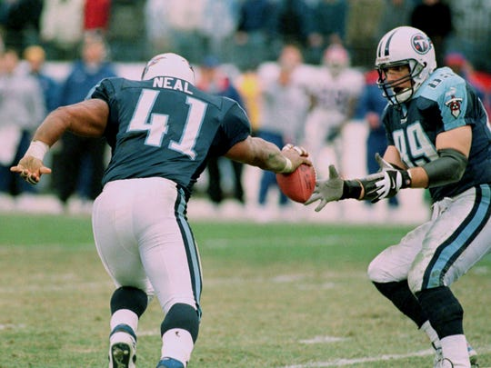 Titans fullback Lorenzo Neal (41) hands the ball off to tight end Frank Wycheck (89) after Neal received a kickoff in the AFC wild-card game on Jan. 8, 2000, starting what became known as the Music City Miracle.