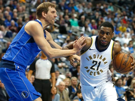 Dallas Mavericks forward Dirk Nowitzki, left, defends as Indiana Pacers forward Thaddeus Young (21) drives inside during the first half of an NBA basketball game, Monday, Feb. 26, 2018, in Dallas. (AP Photo/Ron Jenkins)
