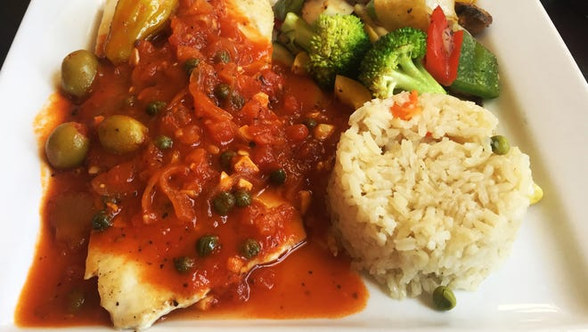 The Fish is Mahi Mahi with Veracruz sauce with vegetables and rice ($12) from Paisano Cafe.