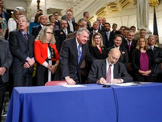 Gov. Tom Wolf signs opioid and heroin legislation