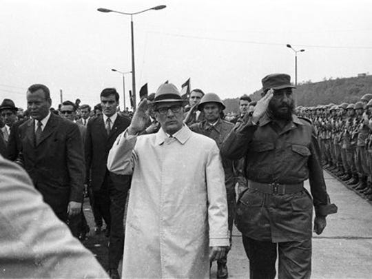 FILE - In this June 1972 file photo, Cuba's leader Fidel Castro, right, reviews troops during his visit to Leuna, formerly the German Democratic Republic.  With Castro is East German President Erich Honecker. Former President Fidel Castro, who led a rebel army to improbable victory in Cuba, embraced Soviet-style communism and defied the power of 10 U.S. presidents during his half century rule, has died at age 90. The bearded revolutionary, who survived a crippling U.S. trade embargo as well as dozens, possibly hundreds, of assassination plots, died eight years after ill health forced him to formally hand power over to his younger brother Raul, who announced his death late Friday, Nov. 25, 2016, on state television.