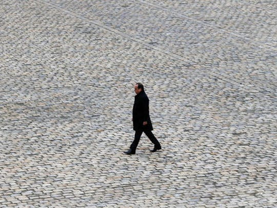 "FILE - In this Friday, Nov. 27, 2015 file picture, French President Francois Hollande walks in the courtyard of the Invalides national monument during a ceremony in Paris, France. French President Francois Hollande says he decided against running for another term because he wants to give his Socialist party a chance to win ""against conservatism and extremism."""