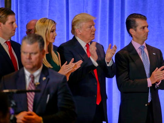 President-elect Donald Trump waits with family members Eric Trump, left, Ivanka Trump and Donald Trump Jr. before speaking at a news conference, Wednesday, Jan. 11, 2017, in New York. The news conference was his first as President-elect.