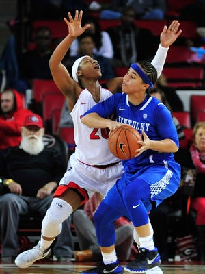 Kentucky guard Makayla Epps (25) elbows Georgia guard/forward Shacobia Barbee (20) during the first half of an NCAA college basketball game Sunday, Jan. 10, 2016, in Athens, Ga. A foul was called on Epps. (AP Photo/Richard Hamm)