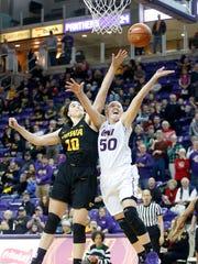 Northern Iowa's Megan Maahs tries to get to the basket