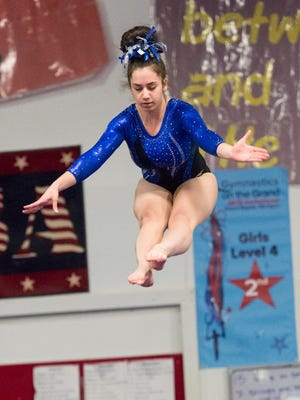 Farmington's Elisa Bills repeated as the all-around state champion in Division 2.