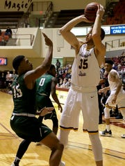 Midwestern State's Nick Powell passes over Eastern