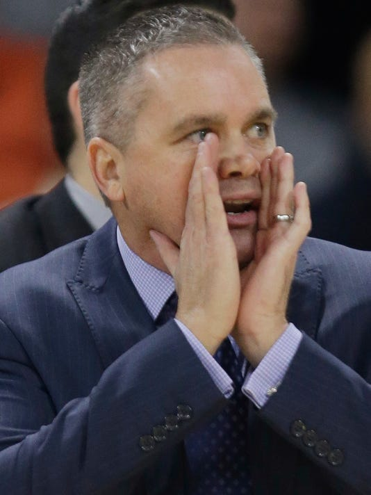 Butler head coach Chris Holtmann reacts to his team's play during the first half of an NCAA college basketball game against Providence, Tuesday, Jan. 19, 2016, in Providence, R.I. (AP Photo/Stephan Savoia)