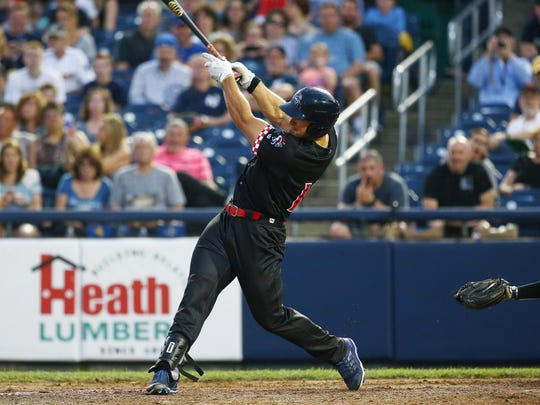 Binghamton Rumble Ponies left fielder Tim Tebow hits a double in the sixth inning against the Trenton Thunder in a three-game series at Arm and Hammer Park.