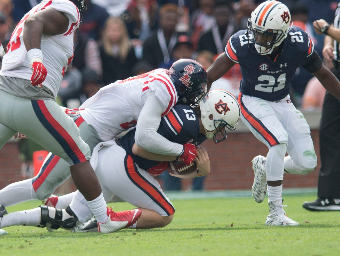 Auburn Tigers quarterback Sean White (13) is sacked by Ole Miss defensive end Marquis Haynes (27) during the NCAA football game between Auburn and Ole Miss on Saturday, Oct. 31, 2015, at Jordan-Hare Stadium in Auburn, Ala. Ole Miss defeated Auburn 27-19.