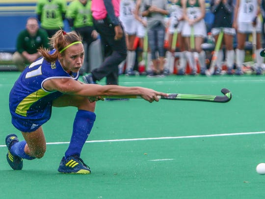 Delaware forward Lisa Giezeman attempts to pass the ball in the box in the first half of the CAA field hockey finals Sunday.
