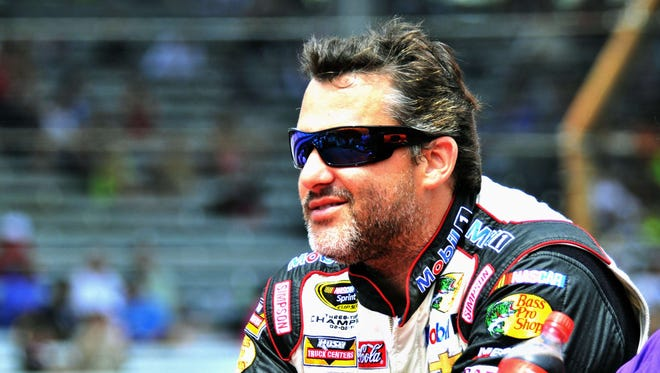 Tony Stewart enjoys the Brickyard 400 pre-race track tour at the the Indianapolis Motor Speedway on July 27, 2014.