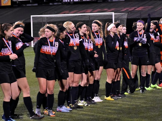 The Lady Tigers of Loveland accept their championship medals at MAPFRE/Crew Stadium in Columbus, Nov. 10, 2017.