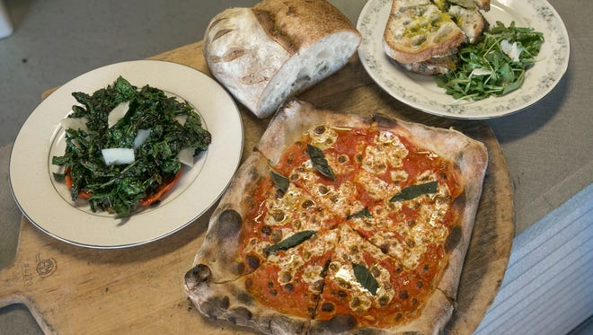 Medusa Stone Fired Kitchen, a new pizza restaurant in Asbury Park. They make stone-fired pizza and sandwiches, salads and soup, plus bread and coffee on the weekends. Tomato pie with fresh baked sour dough bread, charred kale and tomato pecorino (left) and roast pork and salsa verde sandwich  —October 12, 2016-Asbury Park, NJ.-Staff photographer/Bob Bielk/Asbury Park Press