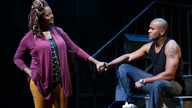 """Christopher Jackson, right, and Tonya Pinkins in a scene from """"Holler If Ya Hear Me"""" at the Palace Theatre in New York. The musical uses Tupac Shakur's songs including """"Me Against the World"""" and """"California Love."""""""
