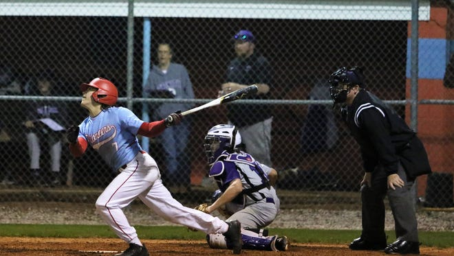 Gibson County's Sam McKinney (7) gets the game-winning hit in the bottom of the sixth inning against TCA on April 2, 2018.