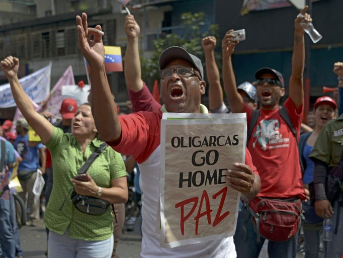 People shout slogans during a farmers rally in support of President Maduro.