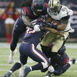 Saints running back Mark Ingram (22) is tackled by Eddie Pleasant (35), Jadeveon Clowney (90) and Quintin Demps (27) of the Houston Texans on Sunday.