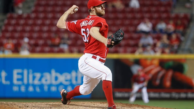 Cincinnati Reds relief pitcher Tony Cingrani throws during the ninth inning of a baseball game against the Milwaukee Brewers, Tuesday, Sept. 13, 2016, in Cincinnati. The Reds won 6-4.