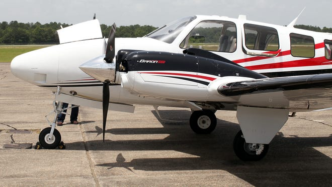 A 2015 Beechcraft Baron 58 sits on the runway at Hattiesburg-Bobby L. Chain Municipal Airport. Hattiesburg City Council recently voted for measures to extend the airport's taxiway.