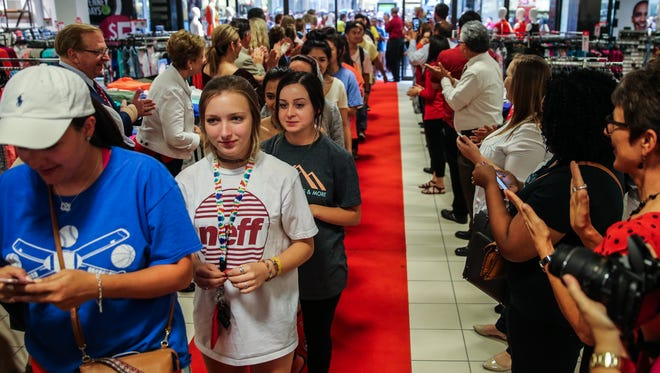 More than 1300 people walk down a red carpet at the Sephora Inside JCPenney grand opening event Friday, June 23, at Sunset Mall.