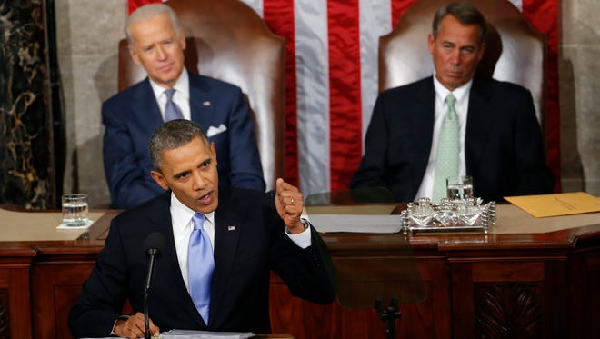 """In this Jan. 28, 2014, photo, Vice President Joe Biden and House Speaker John Boehner of Ohio listens as President Barack Obama gives his State of the Union address on Capitol Hill in Washington.   Obama used his last State of the Union to declare 2014 a """"Year of Action,"""" and he can claim credit for accomplishing several of the goals he laid out.  The smaller ones.  (AP Photo/Charles Dharapak)"""