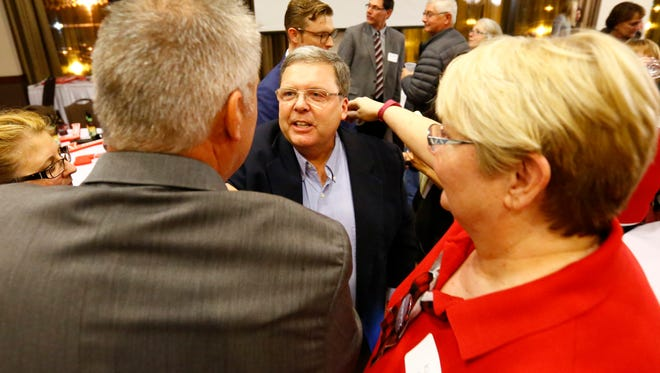85th Assembly winner, Republican Pat Snyder receives congratulations from his supporters Tuesday night at Jefferson Street Inn in downtown Wausau.