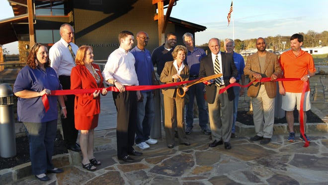 Clarksville Mayor Kim McMillan and former Mayor Johnny Piper, with then-Councilman Bill Summers standing between them, cut the ribbon at Freedom Point during the Liberty Park grand opening in October 2012.