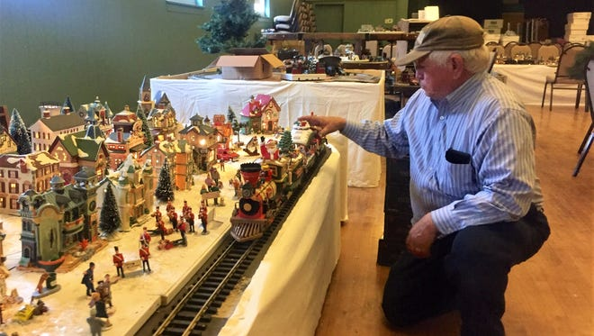 Mike Vandiver prepares one of holiday train scenes for his annual display/fundraiser at St. John's UMC in downtown Anderson. It opens Saturday.