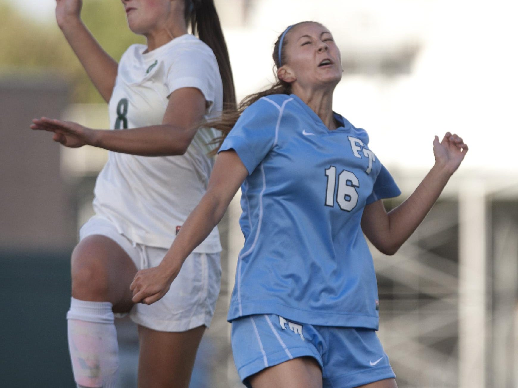 Colts Neck's Amanda Visco and Freehold Township's Megan Cavrak battle for a header during Freehold Township Girls Soccer vs Colts Neck on Thursday September 26, 2013 Colts Neck NJ - Staff Photographer/Peter Ackerman/Asbury Park Press ASB 0926 Freehold Twp Soccer gsccnft130926c