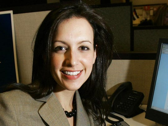 In this March 23, 2007, file photo, Harvard Law School student, Sarah Isgur, poses at her desk. CNN is backing off from its plan to hire Isgur, a former spokeswoman for Attorney General Jeff Sessions, as a politics editor.