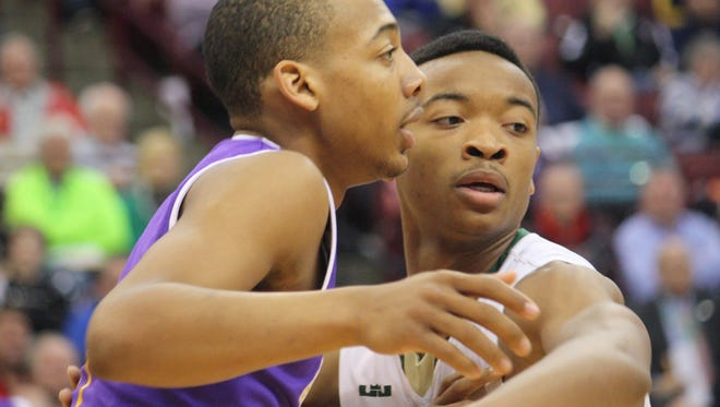 Aiken senior Carlik Jones, left, works to get open in the first half against Akron St. Vincent-St. Mary in a Division II state semifinal March 17, 2016 at Ohio State's Schottenstein Center.