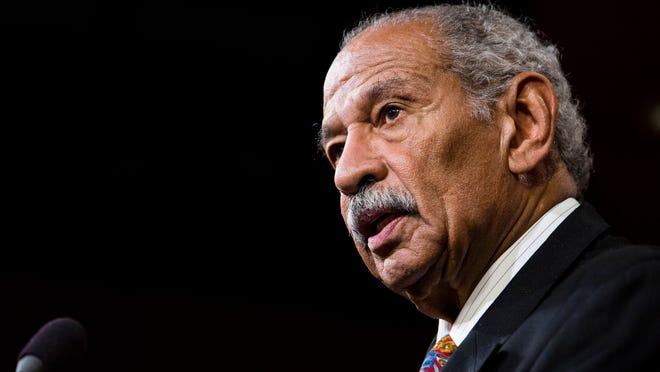 U.S. Rep. John Conyers speaks at a news conference on Capitol Hill in 2014 in Washington, DC.