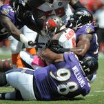 Torrey Smith of the Baltimore Ravens celebrates with Joe Flacco after a 15-yard touchdown reception in the first quarter of the game against the Tampa Bay Buccaneers at Raymond James Stadium on Sunday.