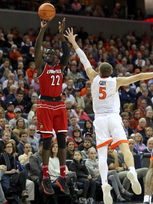 Louisville forward Deng Adel (22) shoots over Virginia guard Kyle Guy (5) during an NCAA college basketball game, Wednesday, Jan. 31, 2018, in Charlottesville, Va. (AP Photo/Andrew Shurtleff)