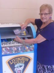 Livingston, N.J., resident Grace Russo drops off medication at a collection box at the Livingston Police Department, installed at the end of June.